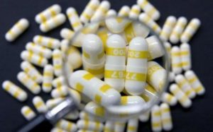 pills under a magnifying glass